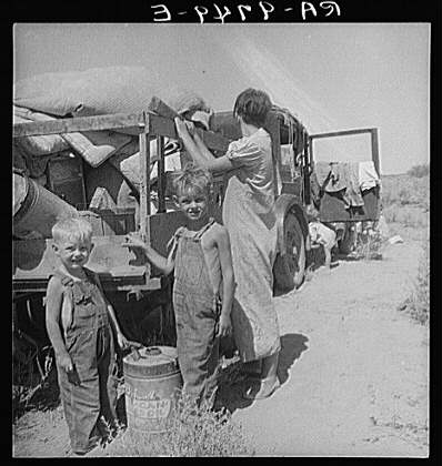 "Part of an impoverished family of nine on a New Mexico highway. Depression refugees from Iowa. Left Iowa in 1932 because of father's ill health. Father an auto mechanic laborer, painter by trade, tubercular. Family has been on relief in Arizona but refused entry on relief roles in Iowa to which state they wish to return. Nine children including a sick four-month-old baby. No money at all. About to sell their belongings and trailer for money to buy food. ""We don't want to go where we'll be a nuisance to anybody."" Children of migrant workers typically had no way to attend school. By the end of 1930 some 3 million children had abandoned school. Thousands of schools had closed or were operating on reduced hours. At least 200,000 children took to the roads on their own. Summer 1936. Photographer: Dorothea Lange. http://www.english.illinois.edu/maps/depression/photoessay.htm"